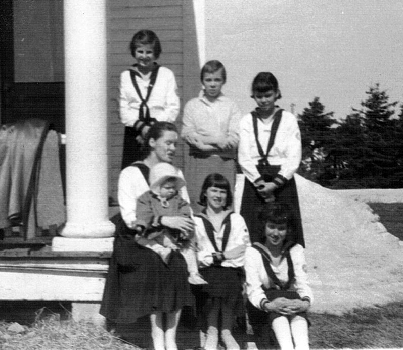 Leading a group of CGIT (Canadian Girls in Training, the United Church's version of Guides) with Heather on her knee, New Mills, NB, 1959